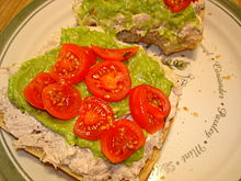 Open_faced_tuna_sandwich_with_cherry_tomato_and_guacamole_spread