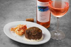 Join Ruth's Chris Steak House in celebrating the Filet Mignon with a special Filet and Rose pairing now through September 5. The special promotion includes a 6 oz. filet, served with three succulent shrimp paired with a glass of Rose for $30. (PRNewsFoto/Ruth's Chris Steak House)